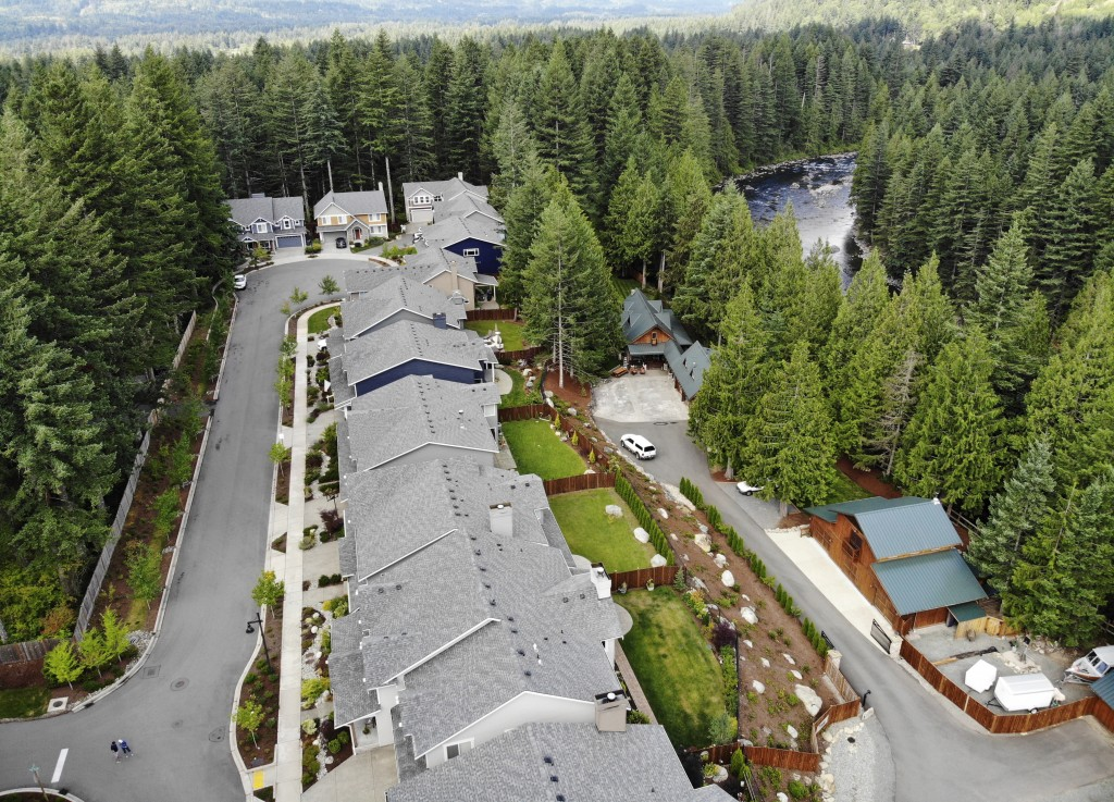 In this photo taken July 24, 2019, a block of houses are carved into a forest along the Middle Fork Snoqualmie River in the Cascade foothills of North...