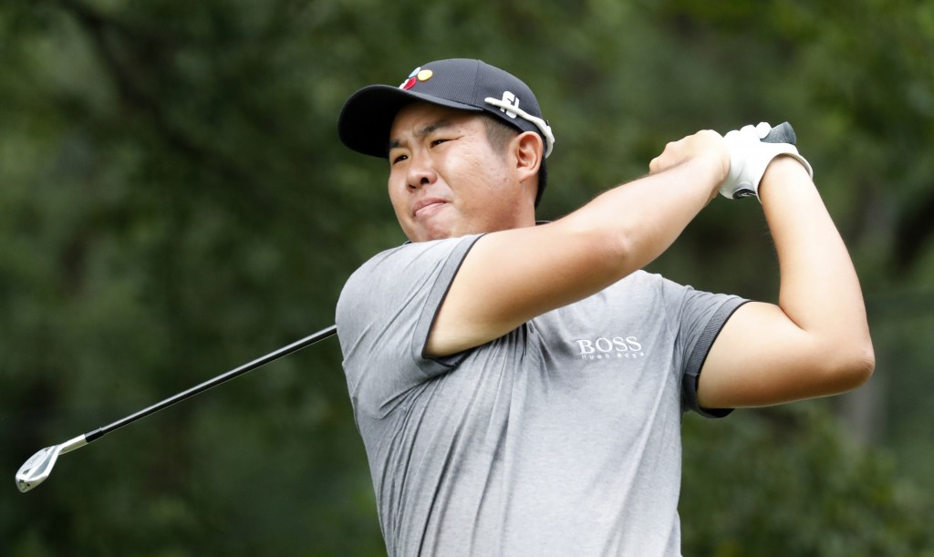 Byeong Hun An watches his tee shot on the fourth hole hole during the third round of the Wyndham Championship golf tournament at Sedgefield Country Cl...
