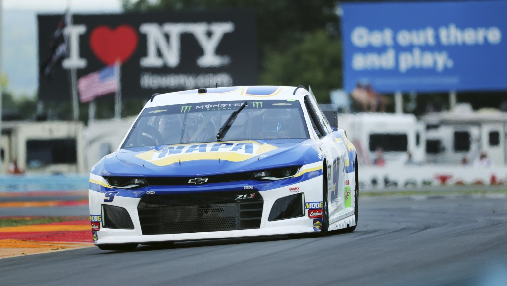 "Chase Elliott (9) drives through the area of the course called ""The Bus Stop"" during a practice run for the NASCAR Cup Series auto race at Watkins Gle"