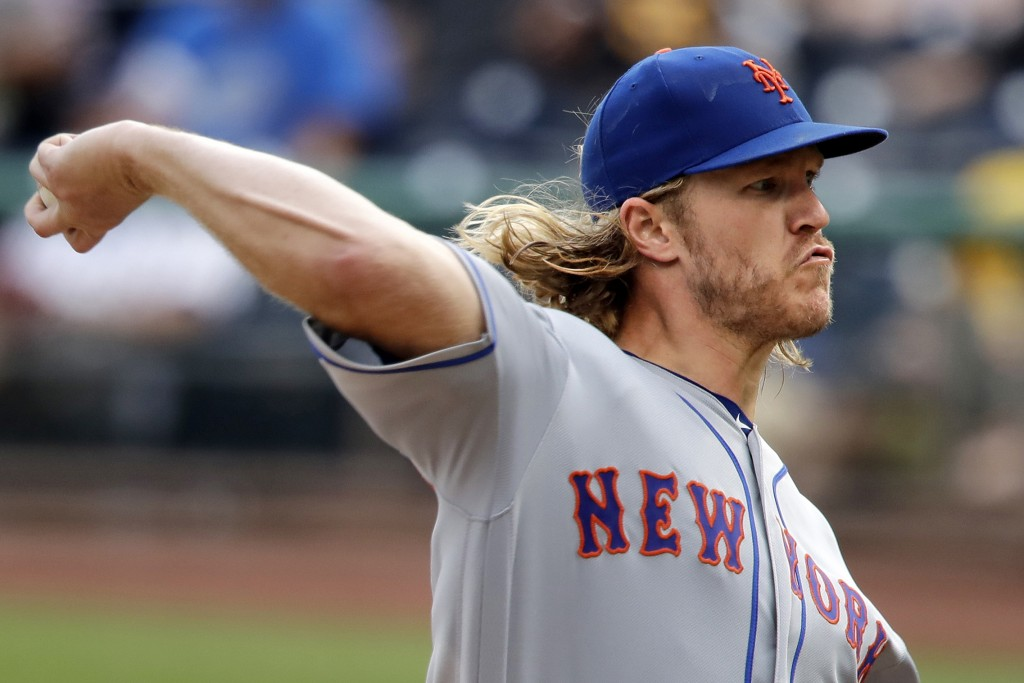 New York Mets starting pitcher Noah Syndergaard delivers during the sixth inning of a baseball game against the Pittsburgh Pirates in Pittsburgh, Sund...