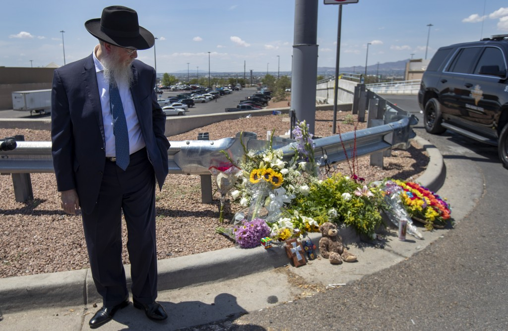 Rabbi Yisrael Greenberg looks at the makeshift memorial while paying tribute to the victims of the Saturday mass shooting at a shopping complex in El ...