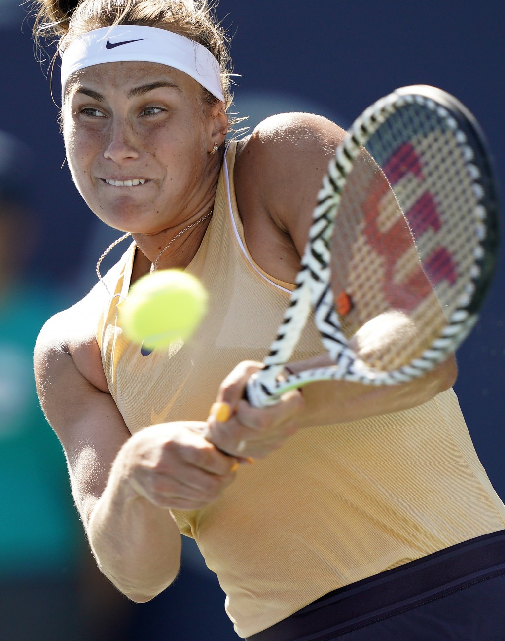 Aryna Sabalenka, of Belarus, hits a backhand to Zheng Saisai, of China, during the finals of the Mubadala Silicon Valley Classic tennis tournament in