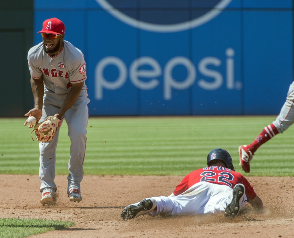 Cleveland Indians' Jason Kipnis, right, steals second base as Los Angeles Angels' Luis Rengifo, left, bobbles the ball during the fifth inning of a ba...
