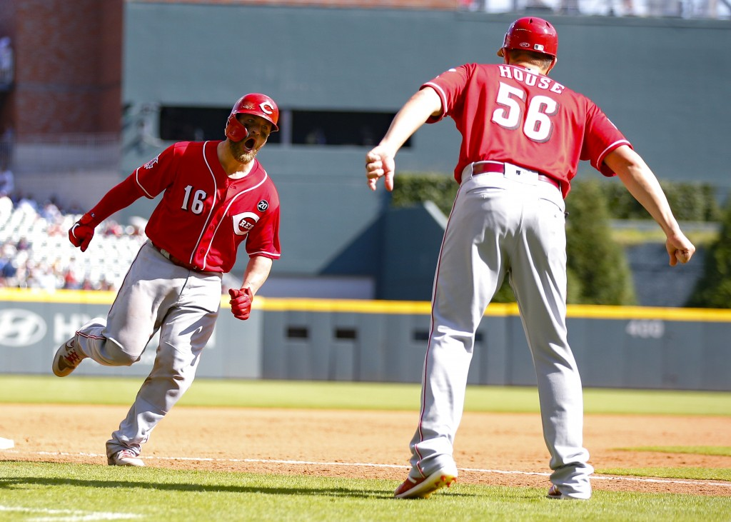 Cincinnati Reds Tucker Barnhart (16) rounds third and reacts with third base/catching coach J.R. House (56) after hitting a three-run home run in the ...