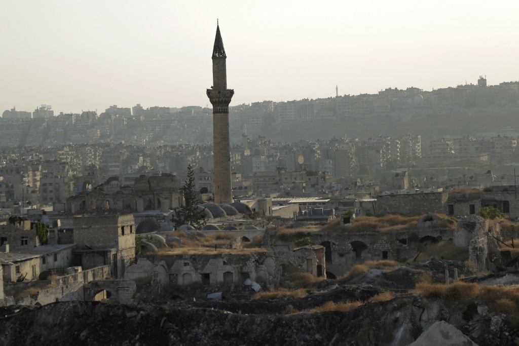 In this Saturday, July 27, 2019 photo, A general view shows the old city of Aleppo, Syria. Much of Aleppo's centuries-old covered market is still in r