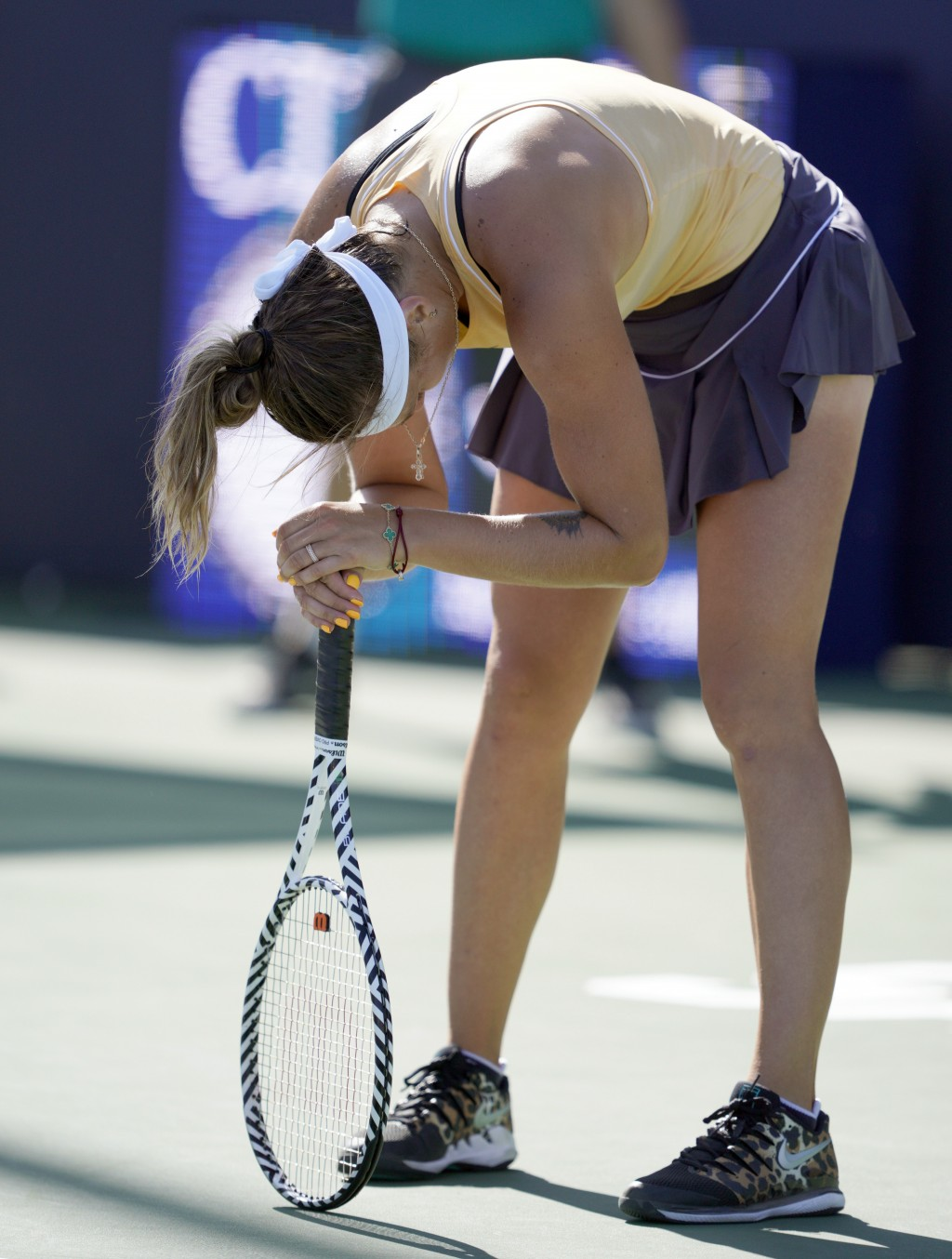 Aryna Sabalenka, of Belarus, reacts after losing the first set against Zheng Saisai, of China, during the finals of the Mubadala Silicon Valley Classi