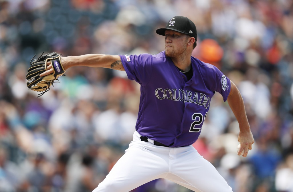Colorado Rockies starting pitcher Kyle Freeland works against the San Francisco Giants in the first inning of a baseball game Sunday, Aug. 4, 2019, in...
