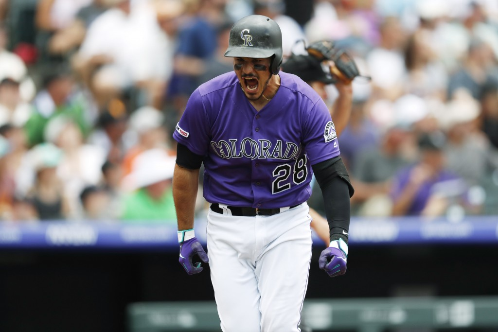 Colorado Rockies' Nolan Arenado reacts after hitting a solo home run off San Francisco Giants starting pitcher Tyler Beede in the first inning of a ba...