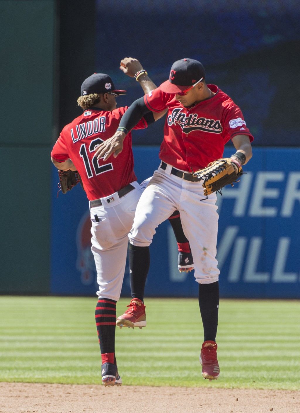 Cleveland Indians' Francisco Lindor and Oscar Mercado celebrate their win over the Los Angeles Angels in a baseball game in Cleveland, Sunday, Aug. 4,