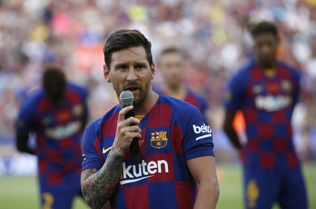 Barcelona forward Lionel Messi addresses the crowd prior of the Joan Gamper trophy soccer match between FC Barcelona and Arsenal at the Camp Nou stadi...