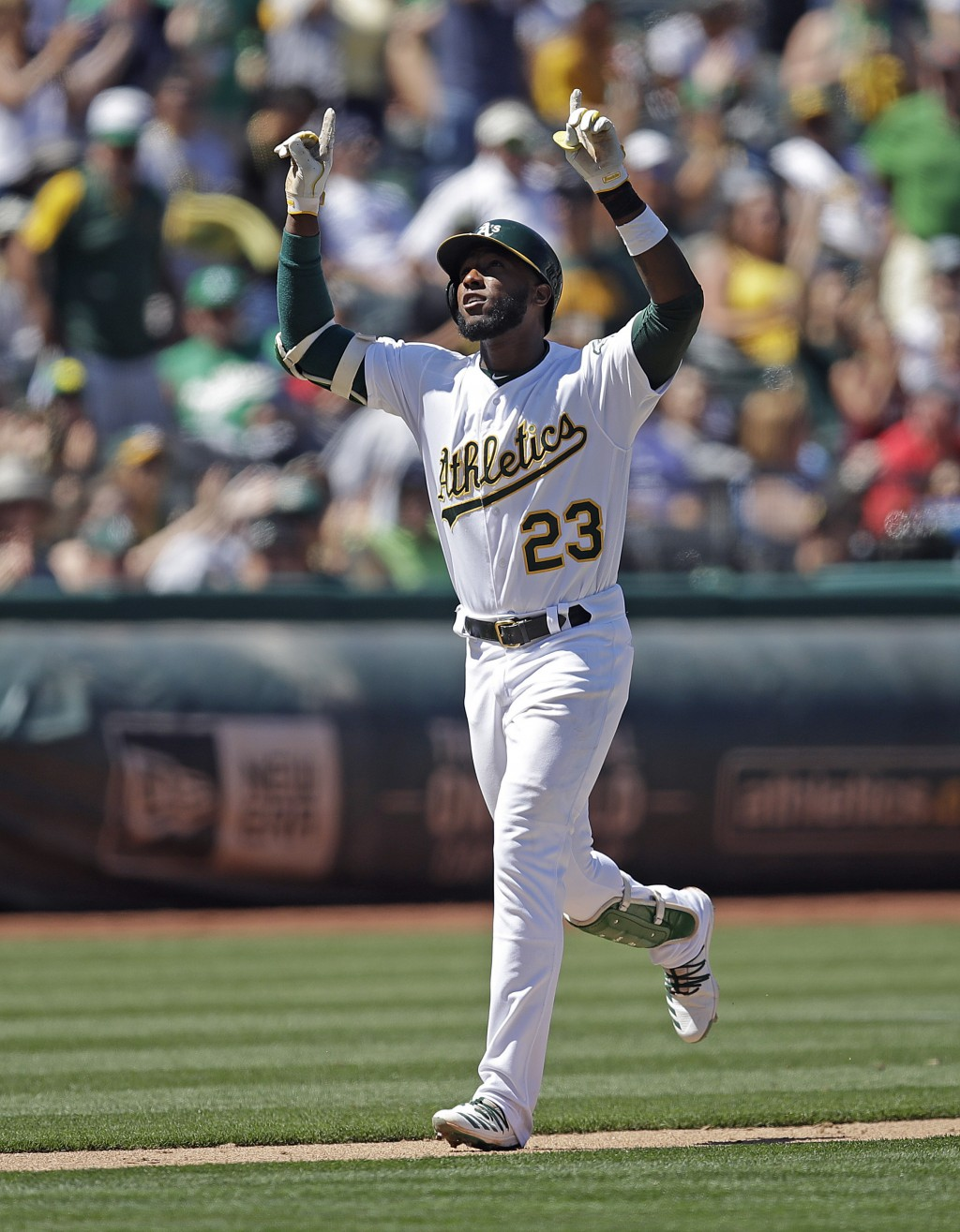 Oakland Athletics' Jurickson Profar celebrates after hitting a home run off St. Louis Cardinals' Adam Wainwright in the sixth inning of a baseball gam