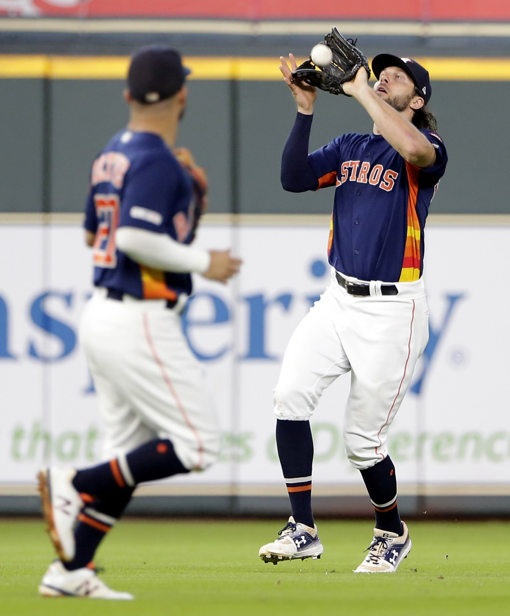 Houston Astros center fielder Jake Marisnick, right, makes the catch on a line drive by Seattle Mariners' Mallex Smith as Jose Altuve, left, looks on