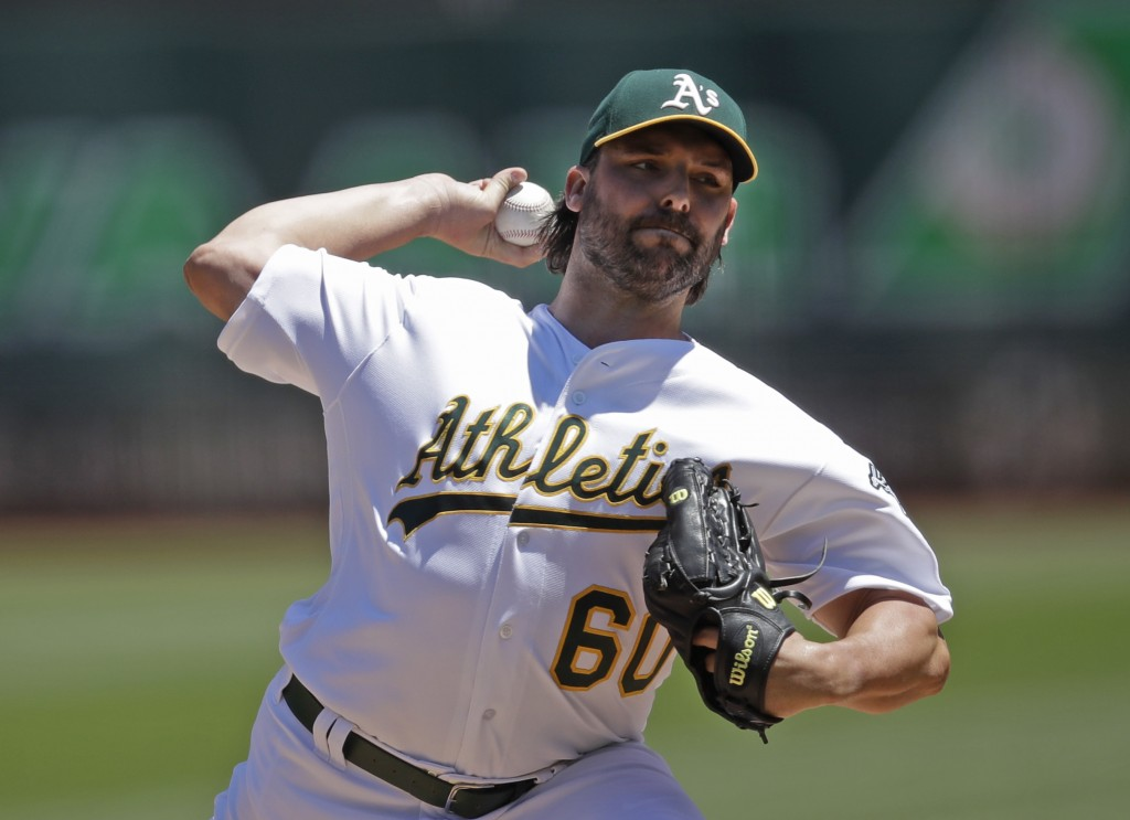 Oakland Athletics' pitcher Tanner Roark works against the St. Louis Cardinals in the first inning of a baseball game Sunday, Aug. 4, 2019, in Oakland,...