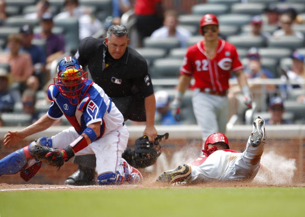 Cincinnati Reds Josh VanMeter (17) slides into home to score as Atlanta Braves catcher Tyler Flowers (25) is late with the tag in the fifth inning of ...