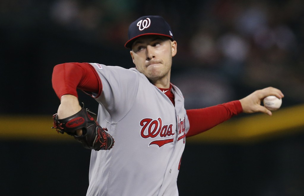 Washington Nationals pitcher Patrick Corbin throws against the Arizona Diamondbacks in the first inning of a baseball game, Sunday, Aug. 4, 2019, in P