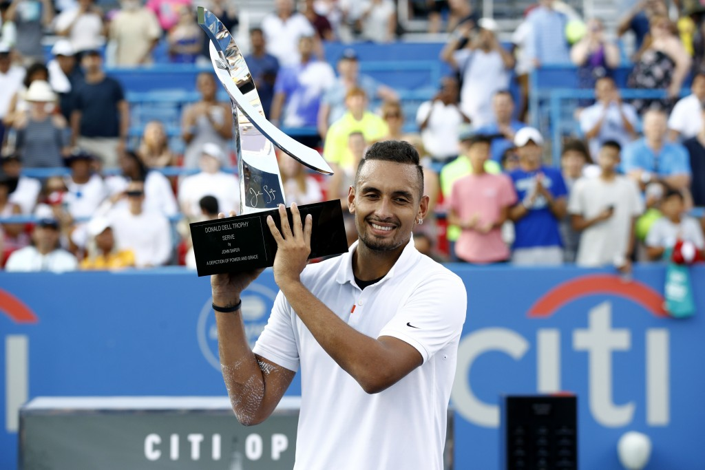Nick Kyrgios, of Australia, poses for photos with a trophy after defeating Daniil Medvedev, of Russia, in a final match at the Citi Open tennis tourna