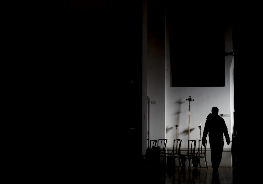 In this Aug. 3, 2019 photo, a man walks inside the Sacred Heart Catholic church in Mendoza, Argentina. In 2017, the Vatican sent two Argentine priests