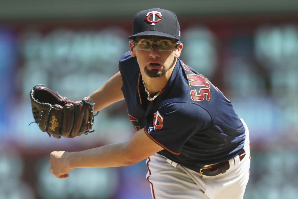 Minnesota Twins pitcher Devin Smeltzer watches a pitch against the Kansas City Royals in the sixth inning of a baseball game Sunday, Aug. 4, 2019, in