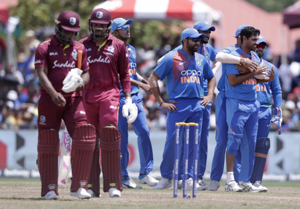 India's Bhuvneshwar Kumar, right, is congratulated after taking the wicket of West Indies' Evin Lewis, left, during the second Twenty20 international ...