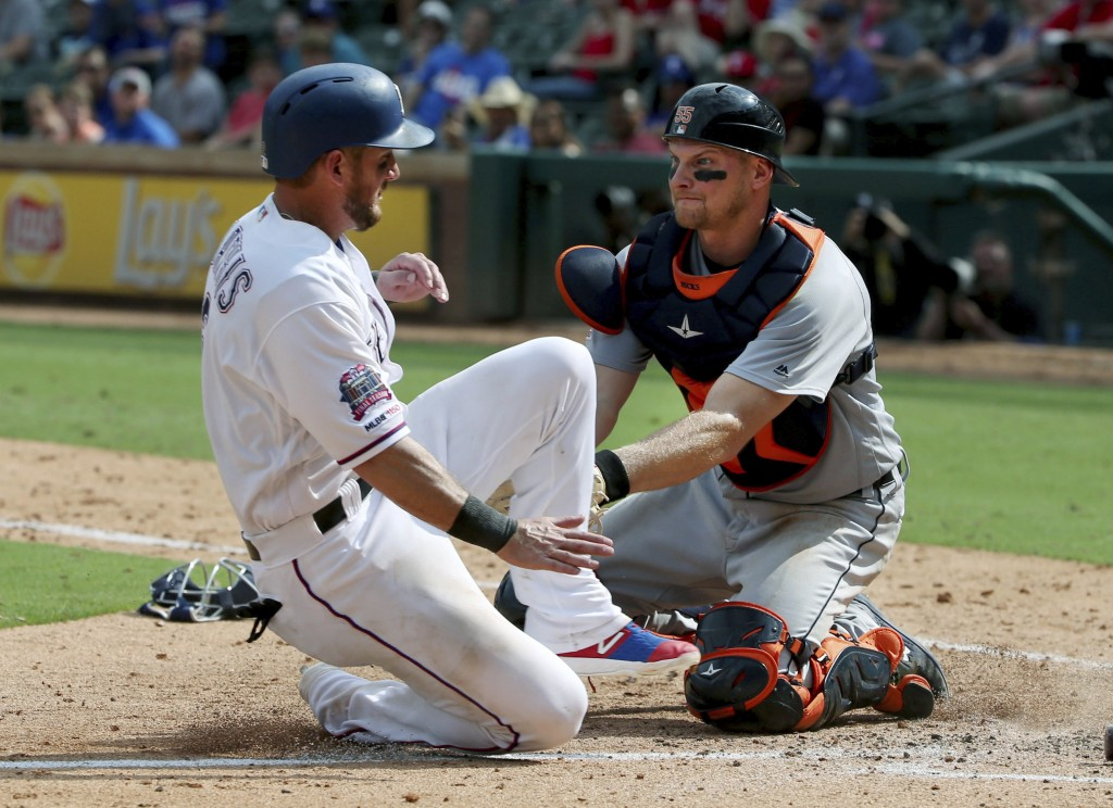 Detroit Tigers catcher John Hicks (55) tags out Texas Rangers Jeff Mathis (2) at home during the seventh inning of a baseball game Sunday, Aug 4, 2019...