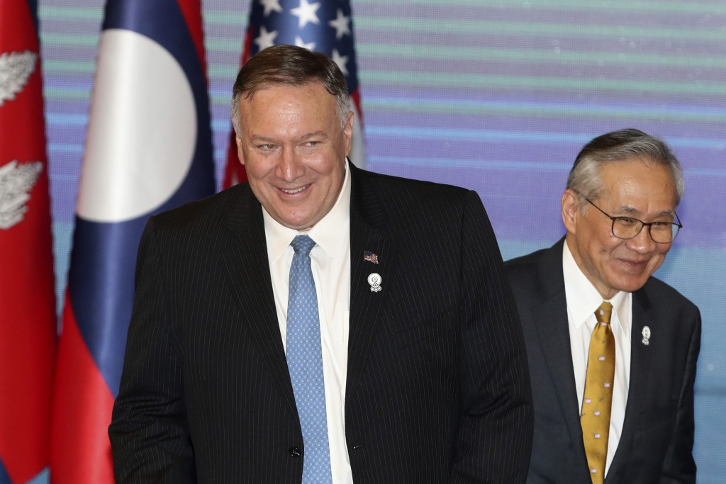 FILE - In this Aug. 1, 2019, file photo, U.S. Secretary of State Mike Pompeo, left, and Thailand's Foreign Minister Don Pramudwinai, get ready for ASE...