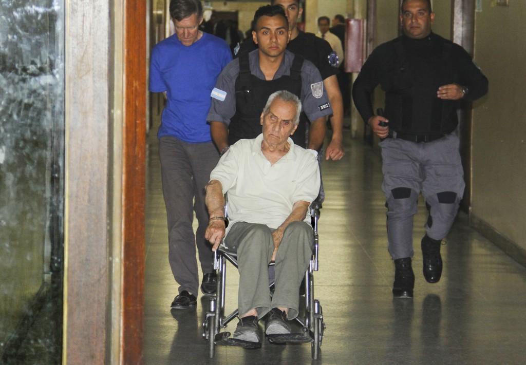 FILE - In this Dec. 22, 2016 file photo, Rev. Horacio Corbacho, far left walking, and Rev. Nicola Corradi, handcuffed to the wheelchair, are escorted ...