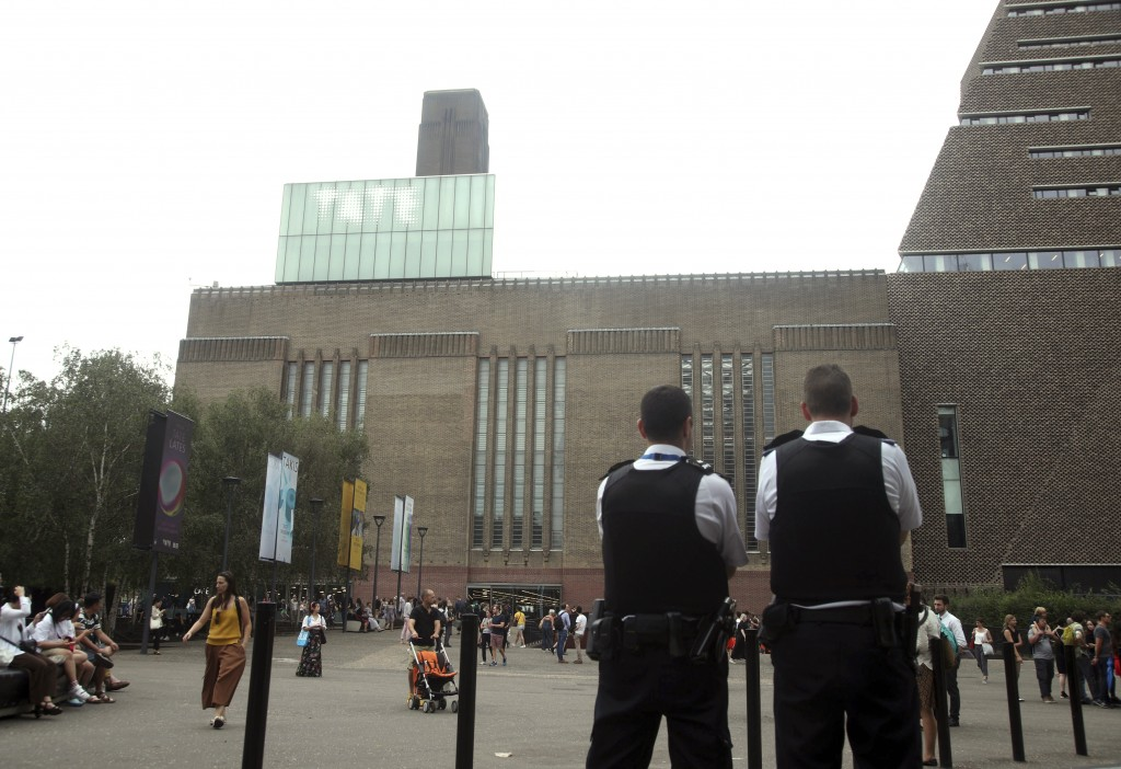 Emergency crews attending a scene at the Tate Modern art gallery, London, Sunday, Aug. 4, 2019. London police say a teenager was arrested after a chil...