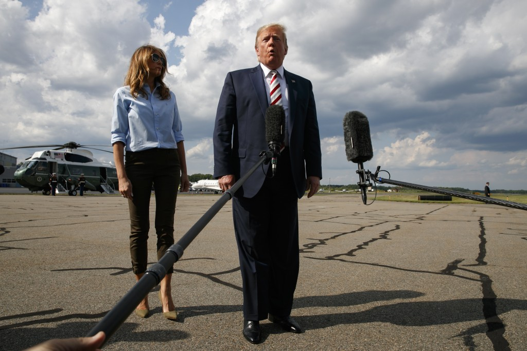 President Donald Trump, with first lady Melania Trump, speaks to the media about the recent mass shootings in El Paso, Texas, and Dayton, Ohio, before