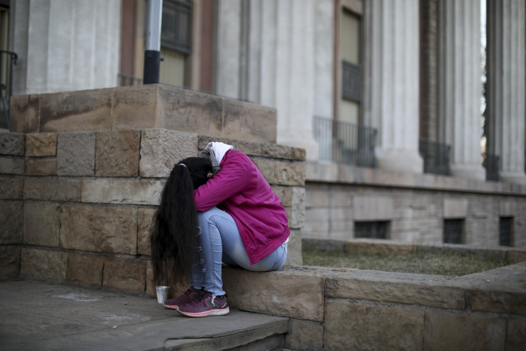 An alleged sexual assault victim from the Antonio Provolo School for Deaf and Hearing Impaired Children sits outside the courtroom in Mendoza, Argenti