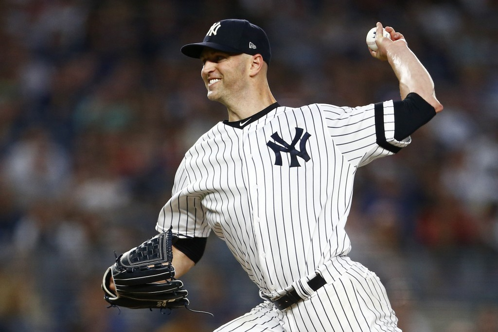 New York Yankees pitcher J.A. Happ delivers during the first inning of a baseball game against the Boston Red Sox, Sunday, Aug. 4, 2019, in New York. ...
