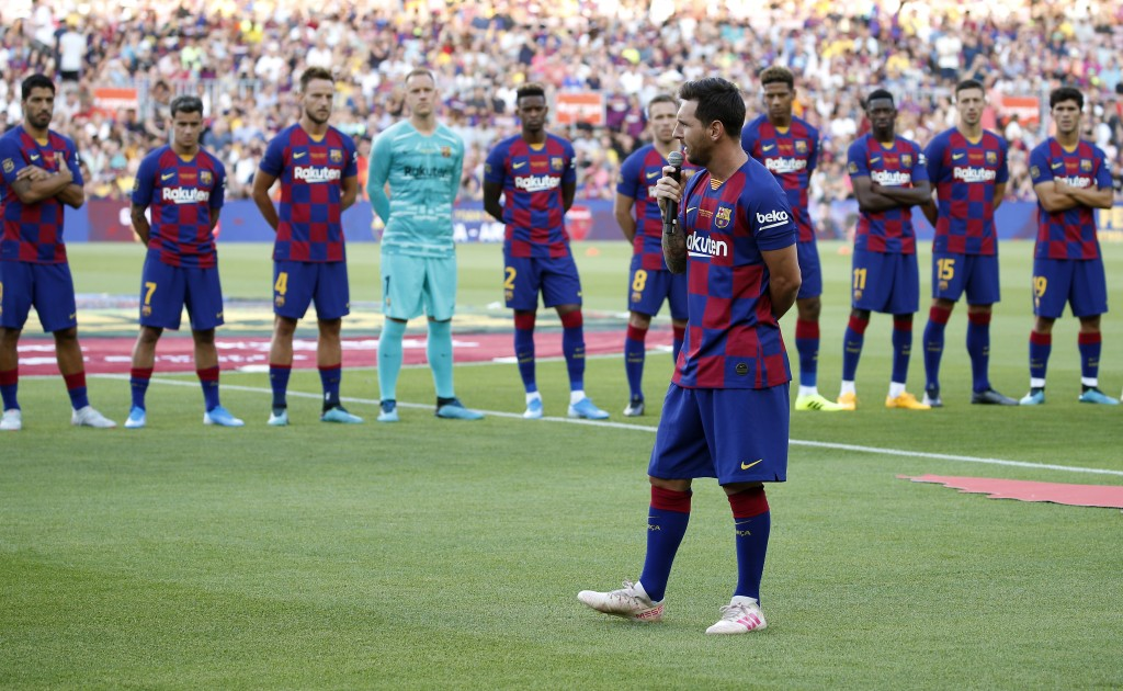 Barcelona forward Lionel Messi addresses to the crowd prior of the Joan Gamper trophy soccer match between FC Barcelona and Arsenal at the Camp Nou st...