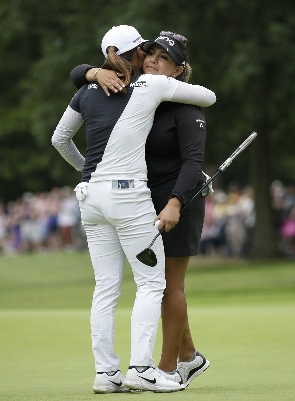 Lizette Salas of the United States, right, embraces, Korea's Ko Jin-young on the 18th green after finishing the final round of the Women's British Ope