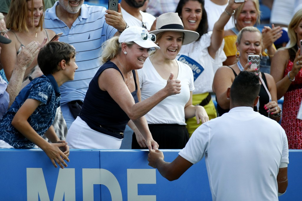 A spectator in the stands gives Nick Kyrgios, bottom right, of Australia, a thumbs-up after he hugged her following his defeat of Daniil Medvedev, of