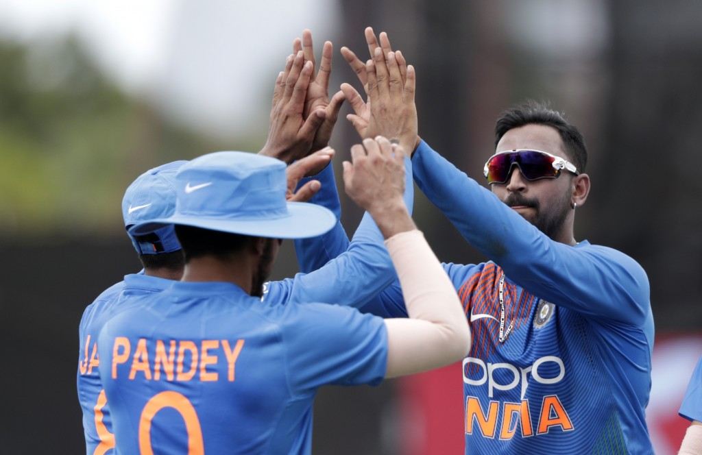 India's Krunal Panda, right, celebrates with India's Manish Pandey, left, after Pandey caught West Indies' Nicholas Pooran during the second Twenty20 ...