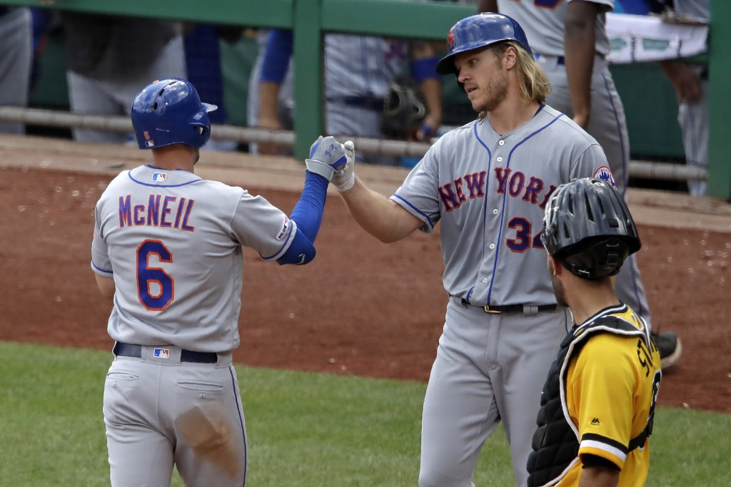 New York Mets' Jeff McNeil (6) is greeted by starting pitcher Noah Syndergaard (34) who was on base for his two-run home run off Pittsburgh Pirates re...