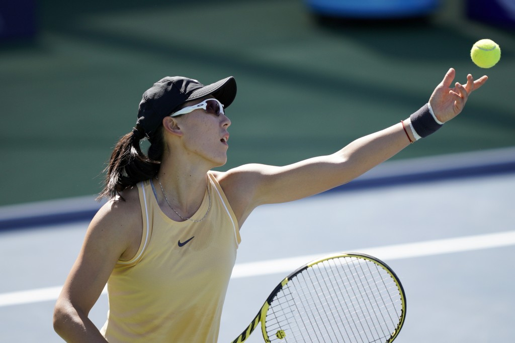 Zheng Saisai, of China, serves the ball to Aryna Sabalenka, of Belarus, during the finals of the Mubadala Silicon Valley Classic tennis tournament in