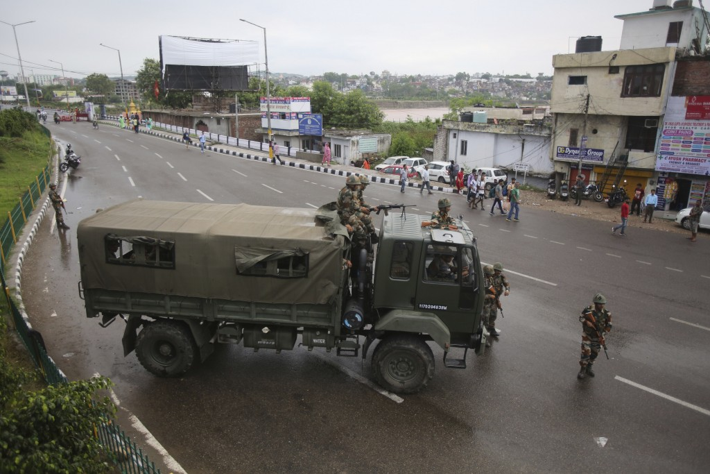 Indian army soldiers guard during curfew like restrictions in Jammu, India, Monday, Aug. 5, 2019. An indefinite security lockdown was in place in the