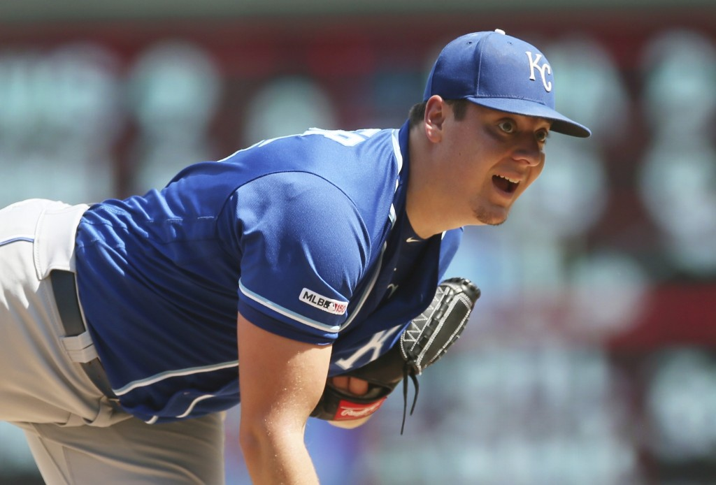 Kansas City Royals pitcher Brad Keller watches his throw against the Minnesota Twins in the fifth inning of a baseball game Sunday, Aug. 4, 2019, in M...