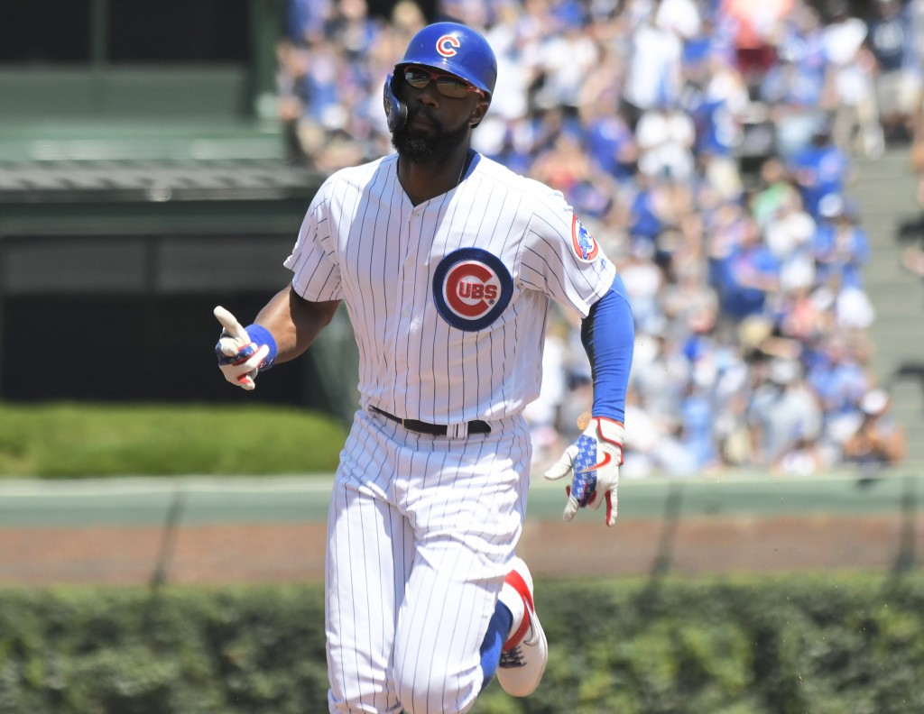 Chicago Cubs' Jason Heyward (22) runs the bases after hitting a home run against the Milwaukee Brewers during the first inning of a baseball game, Sun...