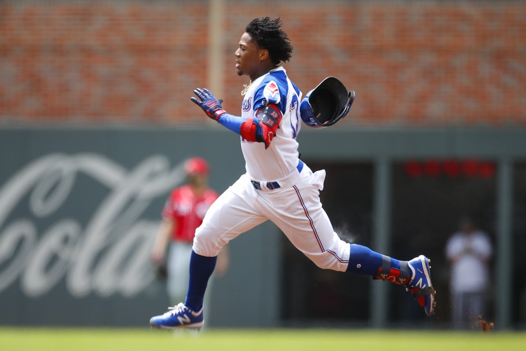 Atlanta Braves center fielder Ronald Acuna Jr. (13) races to second for a double in the first inning of a baseball game against the Cincinnati Reds, S...