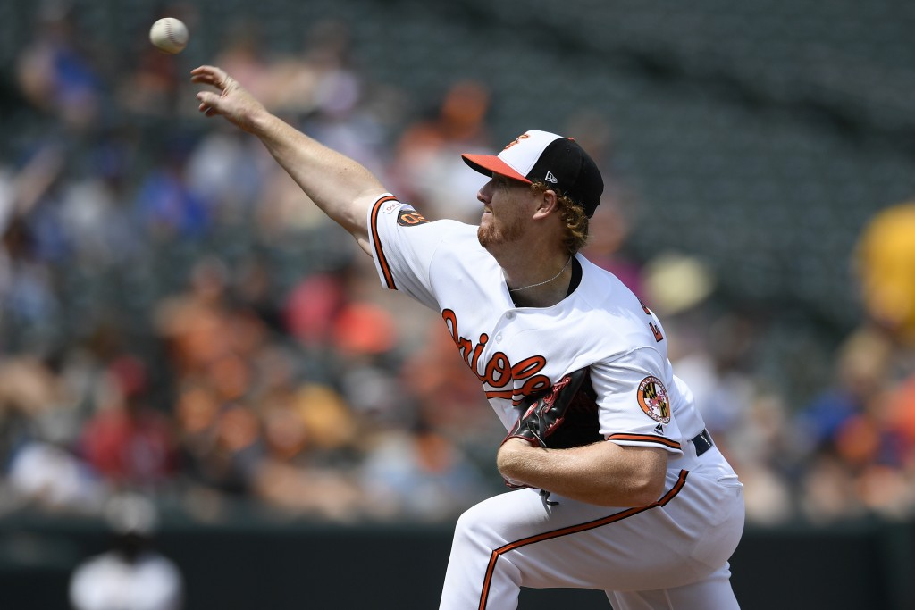 Baltimore Orioles relief pitcher Tom Eshelman delivers during the third inning of a baseball game against the Toronto Blue Jays, Sunday, Aug. 4, 2019,...