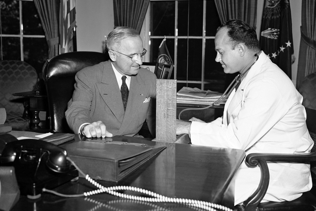 FILE - In this Sept. 3, 1949, file photo, Brigadier Gen. Wallace Harry Graham, right, personal physician of President Harry S. Truman checks his blood