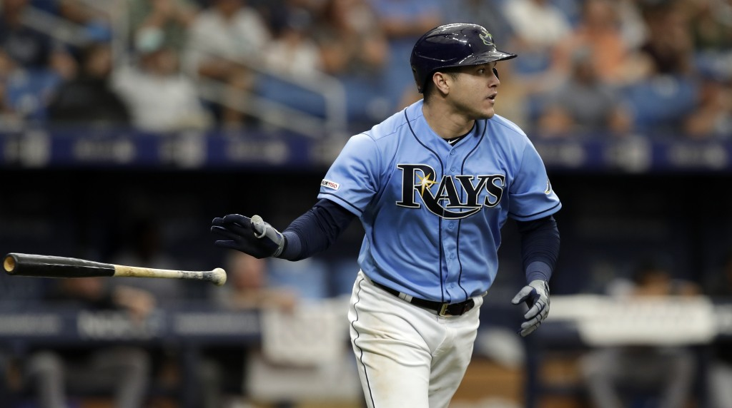 Tampa Bay Rays' Avisail Garcia drops his bat after hitting a two-run double off Miami Marlins relief pitcher Tayron Guerrero during the seventh inning...