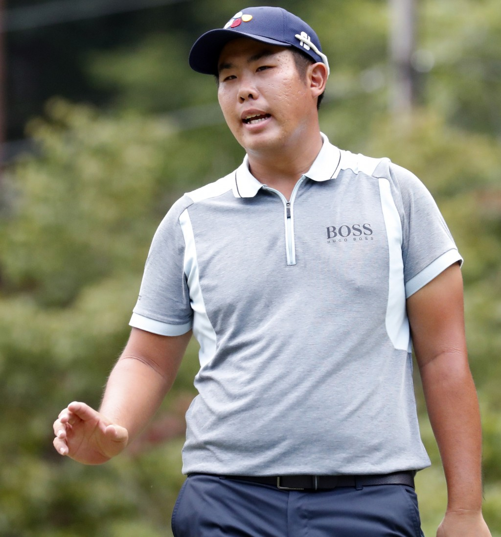 Byeong Hun An waves to the crowd after he made a birdie on the third hole during the final round of the Wyndham Championship golf tournament at Sedgef