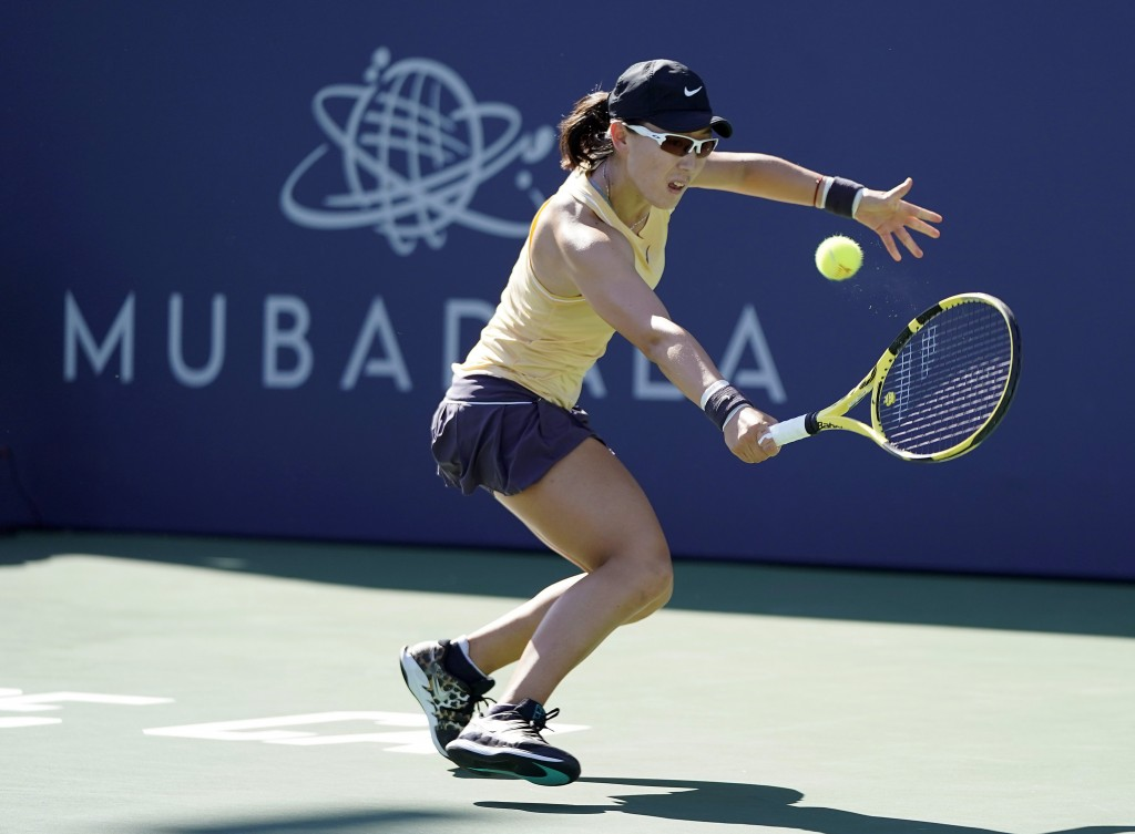 Zheng Saisai, of China, returns the ball to Aryna Sabalenka, of Belarus, during the finals of the Mubadala Silicon Valley Classic tennis tournament in