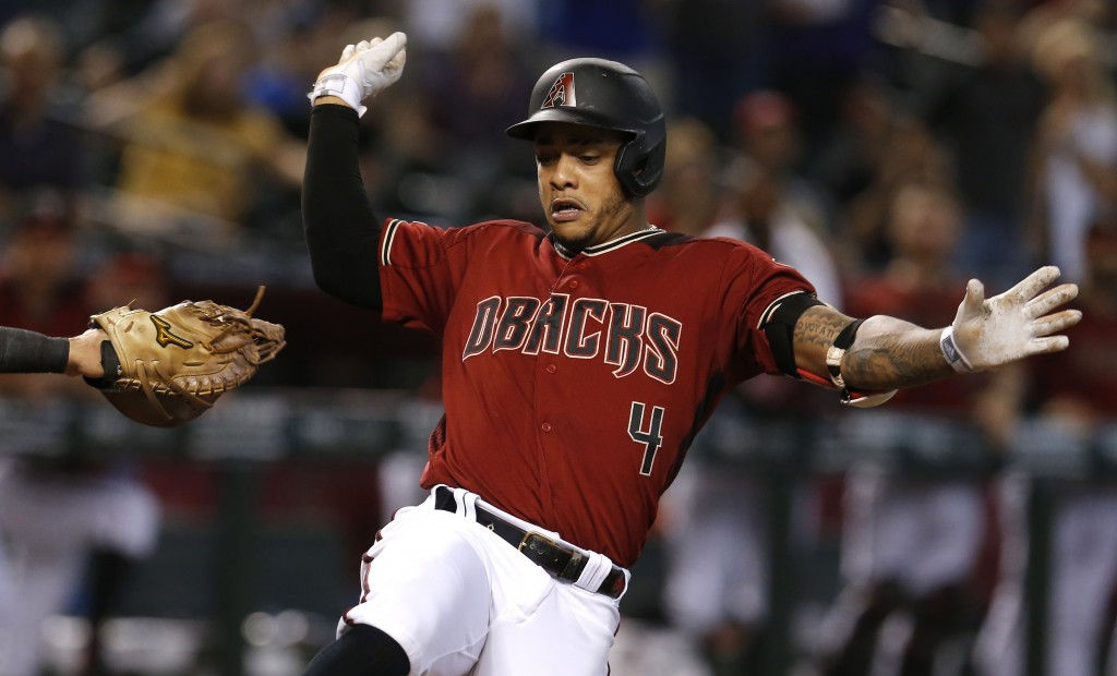 Arizona Diamondbacks' Ketel Marte crosses home plate after hitting an inside-the-park home run against the Washington Nationals in the third inning du