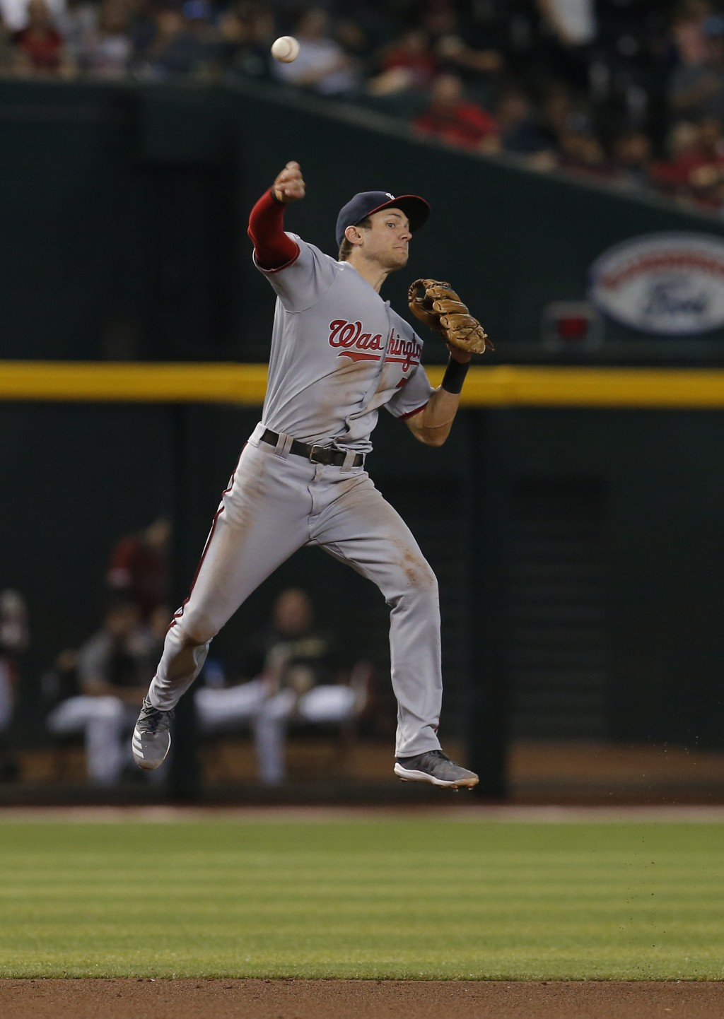 Washington Nationals shortstop Trea Turner makes a off-balance throw for an out on a ball hit by Arizona Diamondbacks' Nick Ahmed in the fourth inning...