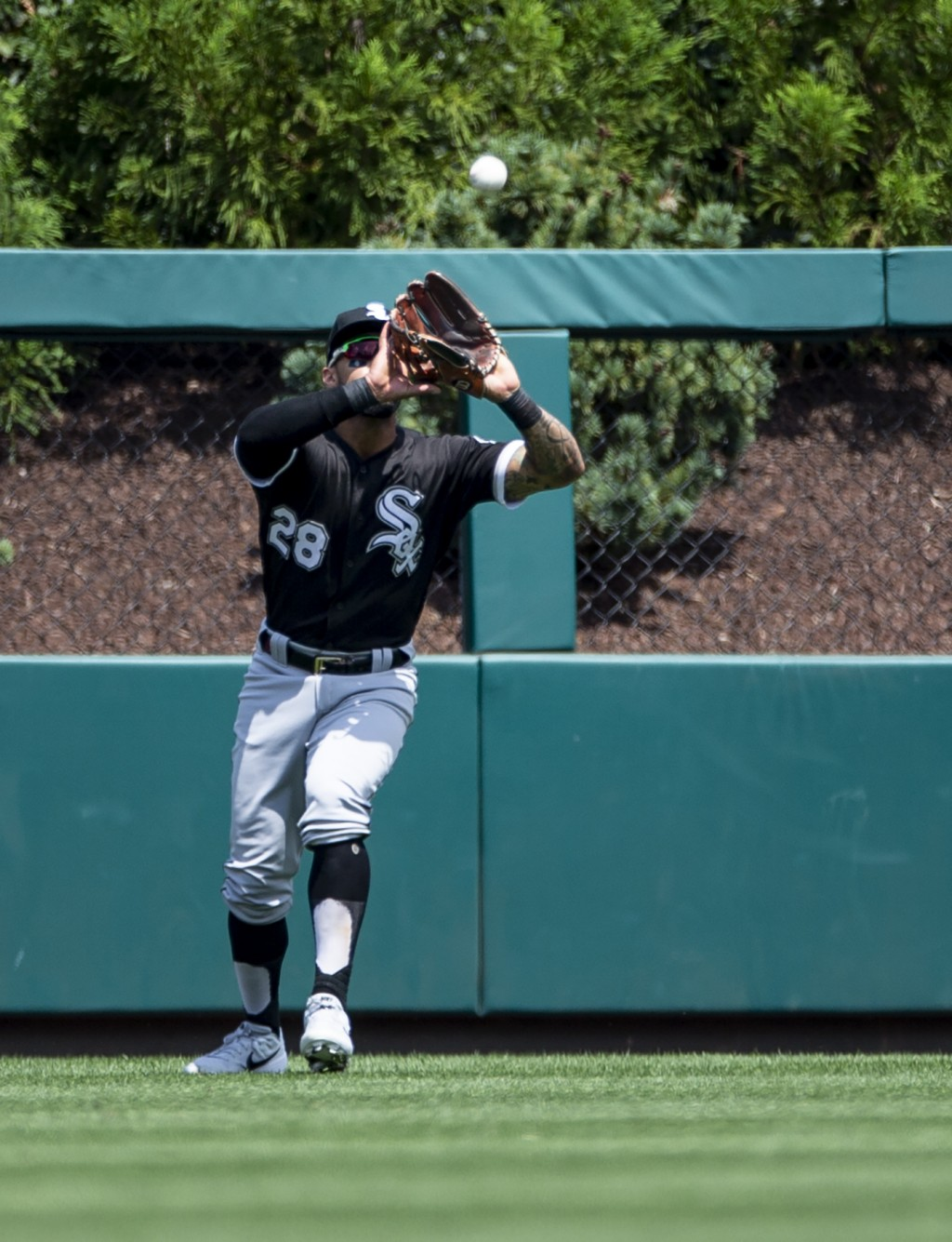 Chicago White Sox center fielder Leury Garcia catches a fly ball hit by Philadelphia Phillies' Jean Segura during the first inning of a baseball game,