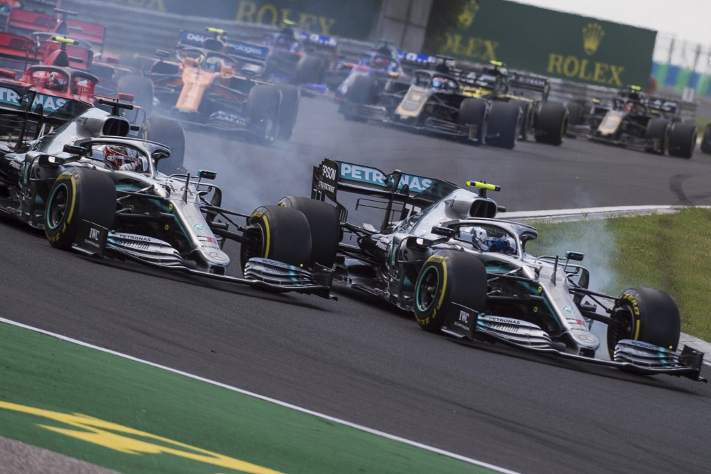 British Forumla One driver Lewis Hamilton of Mercedes, left, and his Finnish teammate Valtteri Bottas steer his car during the Hungarian Formula One G