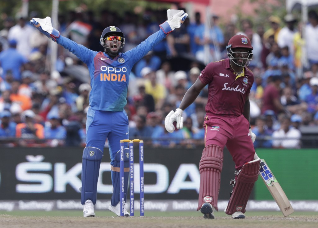 India wicket keeper Rishabh Pant, left, makes a successful LBW appeal on West Indies' Rovman Powell, right, who was out off the bowling of Krunal Pand...